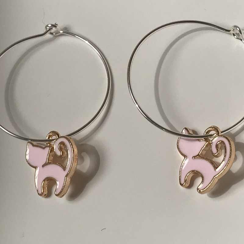 Pink cat charm on silver hoop earring